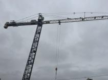 Early, moody, tower crane shot.