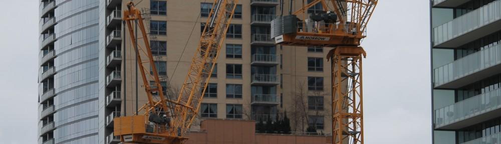 Wanda Vista Tower two cranes