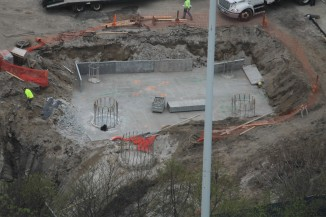 ...as crews readied the foundation.