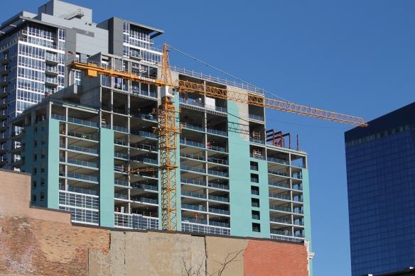 Triple-branded Hilton tower crane removal