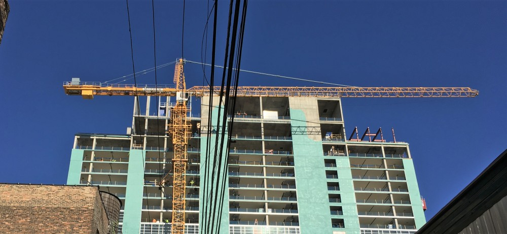 Triple-branded Hilton tower crane removal