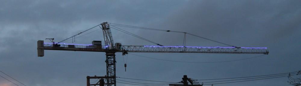 Twelve01West glowing tower crane
