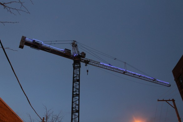 Twelve01West glowing tower crane